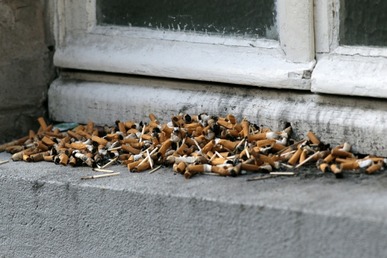 <p>This picture taken on Oct. 25, 2012, shows cigarette butts on a window edge used as an ashtray in Paris.</p>