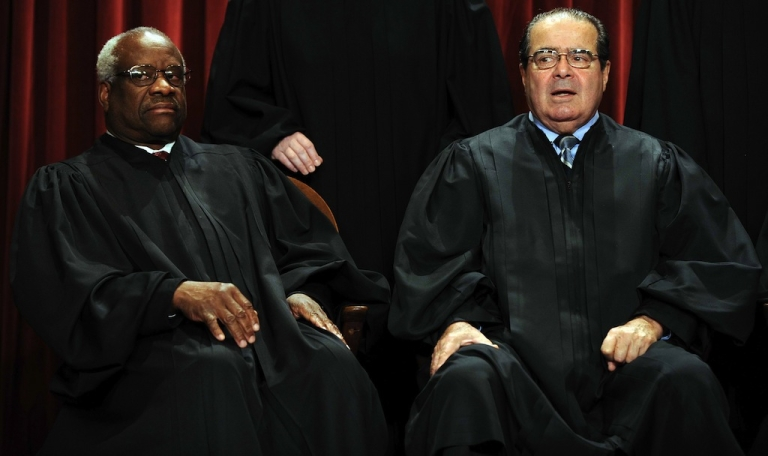 <p>US Supreme Court Associate Justice Clarence Thomas (L) and Supreme Court Associate Justice Antonin Scalia participate in the courts official photo session on October 8, 2010 at the Supreme Court in Washington, DC.</p>