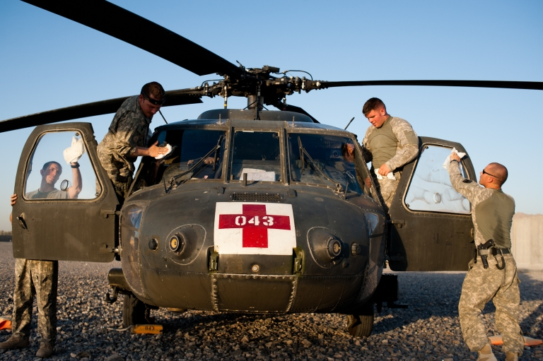 <p>Staff Sgt. Stephon Flynn, Chief Warrant Officer 2 Matt Grove, Spc. Josh Diehl and Chief Warrant Officer 2 Greg Love polish the windows of their medevac helicopter at Forward Operating Base Pasab in Zhari July 2.</p>