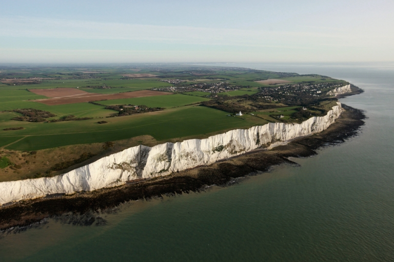 <p>The white cliffs of Dover are seen from the air in Dover, England. The chalk cliffs, which at points stand over 100 metres high, represent the closest point in England to mainland Europe.</p>