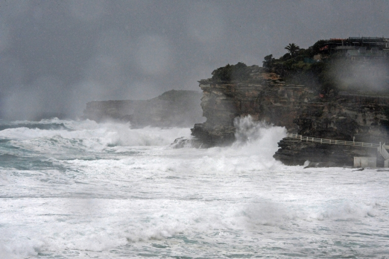 <p>Wild surf breaks on cliffs on the coast of Sydney. Don Ritchie, a local hero who was also known as