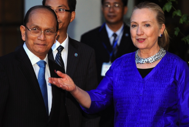 <p>US Secretary of State Hillary Clinton (R) welcomes Myanmar President Thein Sein (L) before a meeting in Siem Reap on July 13, 2012. US Secretary of State Hillary Clinton met Myanmar President Thein Sein on July 13 for landmark discussions days after Washington eased its sanctions on the once-pariah state.</p>