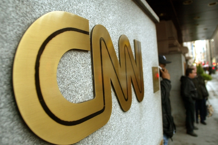 <p>The CNN sign is seen outside its headquarters November 12, 2002 in New York City.</p>
