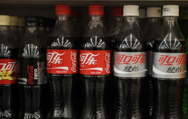 <p>This file picture taken on March 18, 2009 shows bottles of Coca-Cola on the shelves of a store in Beijing.</p>