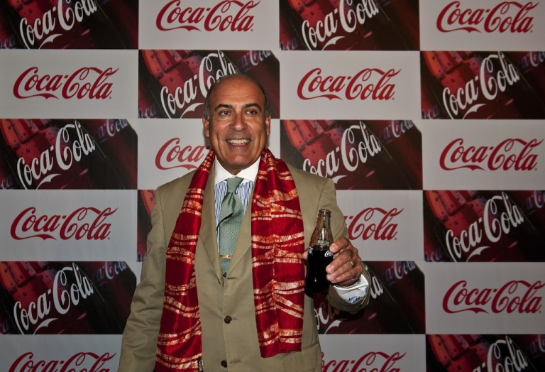 <p>Muhtar Kent, chief executive of Coca-Cola Co, poses with a bottle of the company's trademark beverage during a press conference in New Delhi on June 26, 2012.</p>