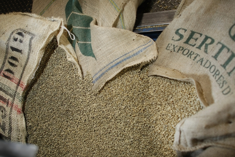 <p>Green coffee beans wait to be poured into the roaster at Colonial Coffee Roasters March 3, 2008 in Miami, Florida. Coffee prices recently hit its highest level in 34 years.</p>