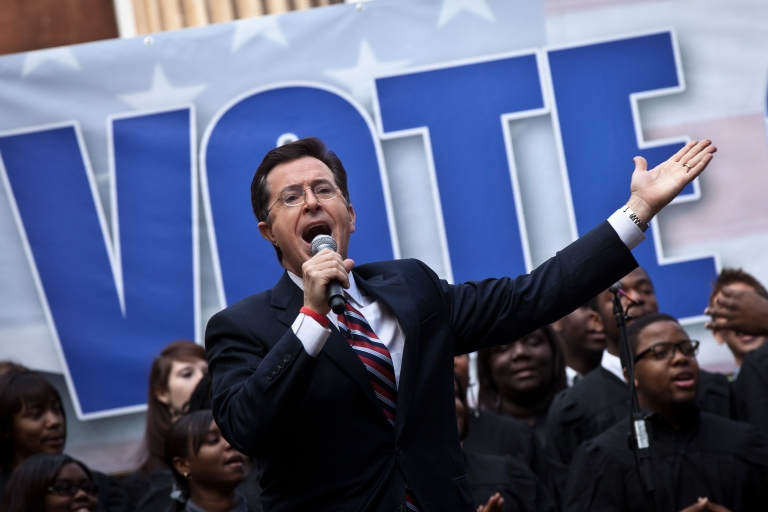 <p>Comedian Stephen Colbert hosts a rally with former Republican presidential candidate Herman Cain on Jan 20 in Charleston, South Carolina.</p>
