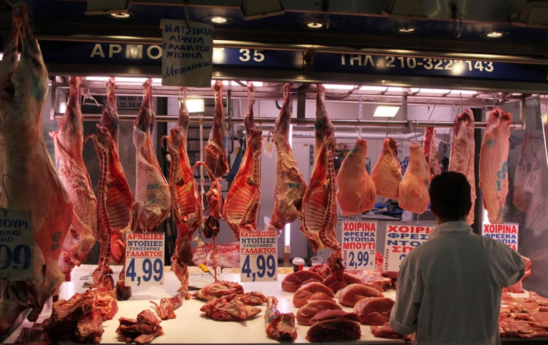 <p>Meat is displayed for sale on a stall in the market in the city center of Athens.</p>