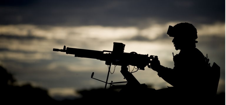 <p>Gunning for peace? A Colombian army soldier mans a turret machine gun in Miranda, in the Cauca department, as part of a task force to fight the FARC guerrilla group. Violence between the military and FARC has escalated even as the groups prepare for peace talks.</p>