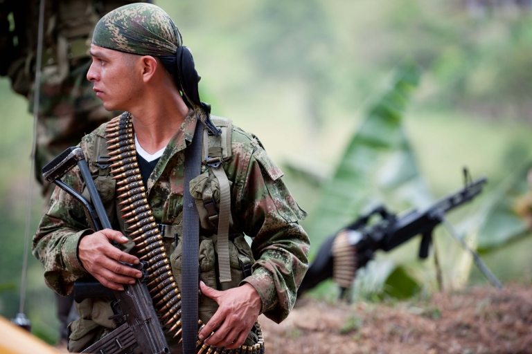<p>A member of the Revolutionary Armed Forces of Colombia (FARC) guerrillas mans a checkpoint near the town of Toribio, in the Colombian department of Cauca.</p>