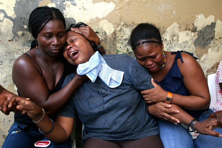 <p>Colombian relatives grieve the death of six miners killed by an unidentified group in 2007 in Quibdo, in the impoverished, mostly Afro-Colombian department of Choco. A survivor said the miners were hacked with machetes and shot at.</p>