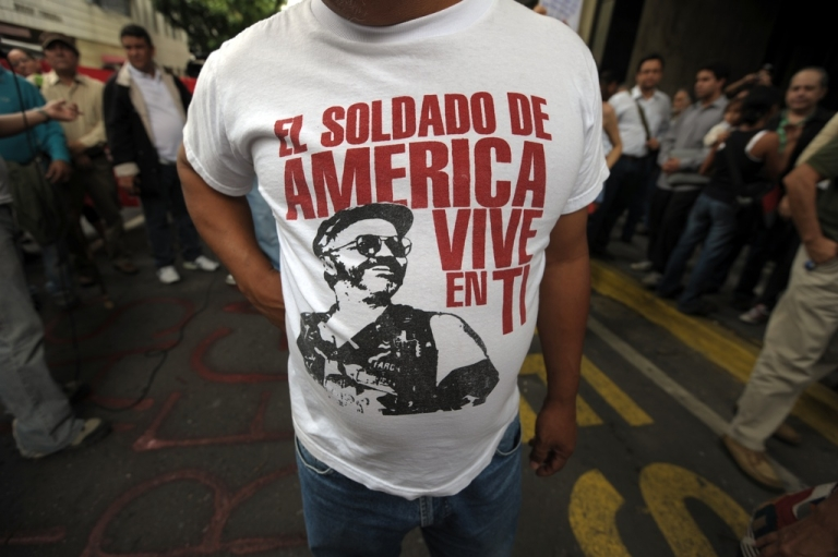 <p>A Bolivian activist wears a T-shirt with the picture of killed FARC leader Raul Reyes and a inscription that reads