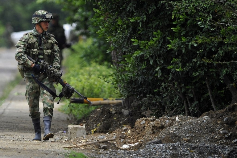 <p>A Colombian soldier is seen here during combat with guerilla troops.  Former Colombian navy Colonel Luis Fernando Borja Giraldo has been sentenced to 21 years in prison for the murder of civilians.  He then had them dressed as guerilla soldiers to create a