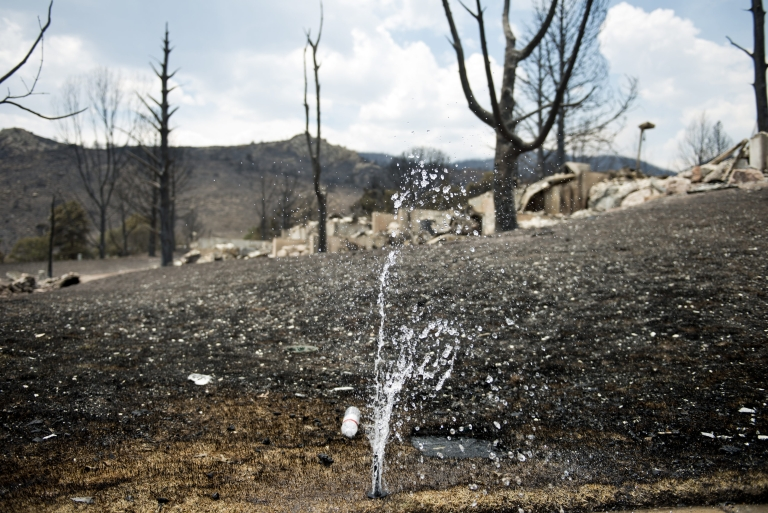 <p>President Obama pledged federal aid for the devastation left behind by wildfires in Colorado. The Waldo Canyon Fire has killed two people and destroyed 347 homes as of June 30, 2012.</p>