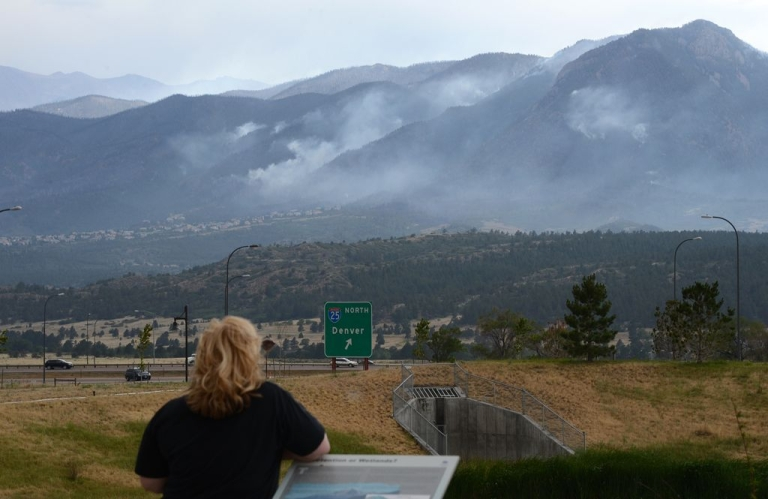 <p>A local resident watches smoke from the Waldo Canyon fire, June 28, 2012 near the Air Force Academy in Colorado Springs, Colorado.</p>