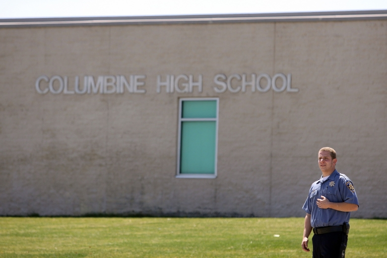 <p>A security officer stands guard at Columbine High School on the 10-year anniversary of the shootings there on April 20, 2009 in Littleton, Colorado. Gun violence in schools has been cut dramatically since Columbine students Dylan Klebold and Eric Harris killed 12 students and a teacher.</p>