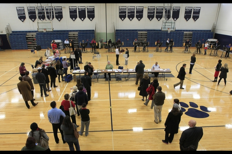 <p>Voters stand on line at the polls November 6, 2012 in Columbus, Ohio.</p>