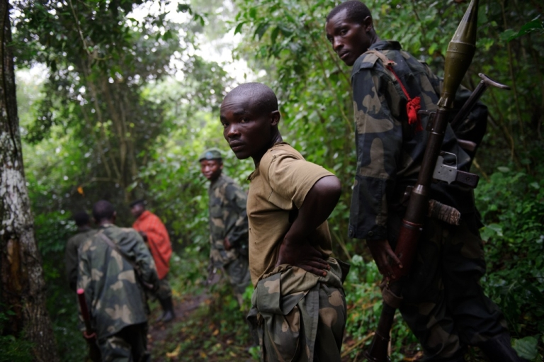 <p>M23 rebels walk through the jungle in the Democratic Republic of the Congo's restive North Kivu province on July 28, 2012.</p>