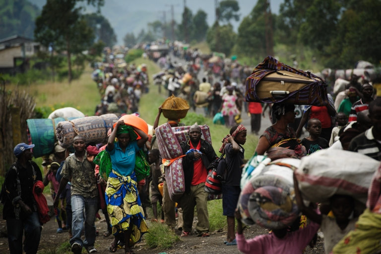 <p>Thousands of Congolese flee the town of Sake, 26km west of Goma, following renewed fighting in the eastern Democratic Republic of the Congo town on Nov. 22.</p>