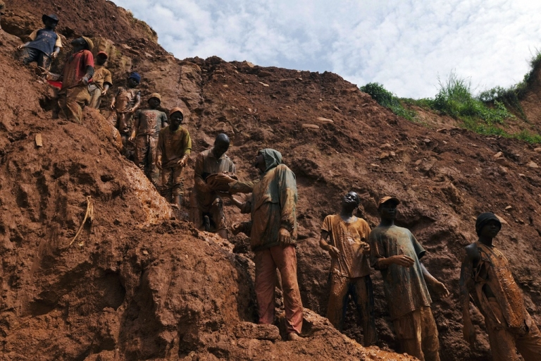 <p>Men work in a gold mine on Feb. 23, 2009, in Chudja, near Bunia, north eastern Congo.</p>