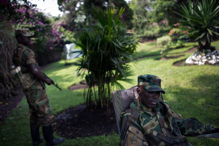 <p>The head of the M23 rebel military forces, Brigadier-General Sultani Makenga (R), sits on November 25, 2012 in the yard of a military residence in Goma in the east of the Democratic Republic of the Congo. Over half a million people have been displaced  in eastern Congo since the outbreak of the M23 rebellion.</p>