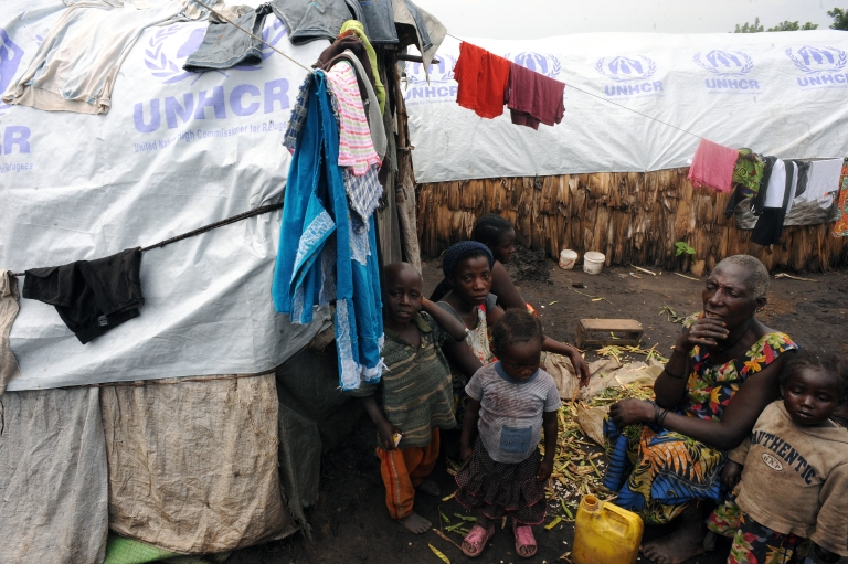 <p>A displaced Congolese family sits outside their tented dwelling in North Kivu on November 30, 2011. After decades of conflict and mismanagement, the Democratic Republic of Congo, a country two-thirds the size of Western Europe, is still plagued by by violence and abject poverty.</p>