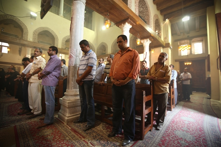 <p>Coptic Christians attend a service in the Church of St Barbera on May 27, 2011 in Coptic Cairo, Egypt. Copts have found themselves at the center of an international crisis after a video made by an American Coptic Christian ignited violent protests across the Muslim world.</p>