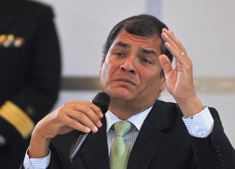 <p>Ecuadorean President Rafael Correa speaks with foreign correspondents in Quito on February 16, 2012.</p>