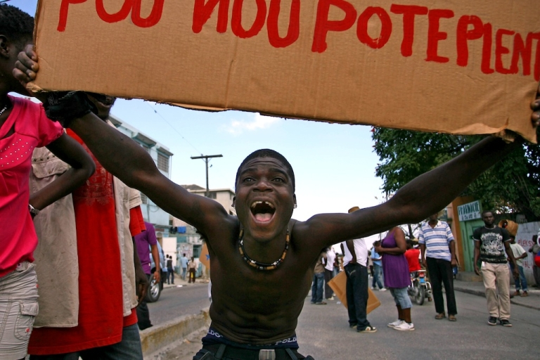 <p>A man protests political corruption at a demonstration in Port-au-Prince, Haiti, on January 23, 2011.</p>