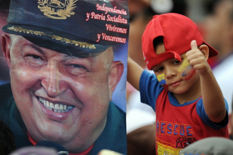 <p>#172 — Venezuela<br /> A boy gives a thumbs up as he holds a poster of Venezuelan President Hugo Chavez during a ceremony to celebrate the Day of the Student at the presidential palace Miraflores in Caracas on Nov. 21, 2011.</p>