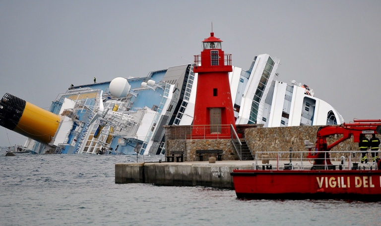 <p>Firemen patrol the area near the Costa Concordia cruise ship in the harbor of the Tuscan island of Giglio. At least 17 people died when the ship struck rocks and keeled over onto its side as it carried out a traditional salute to islanders last month. Fifteen people remain unaccounted for.</p>