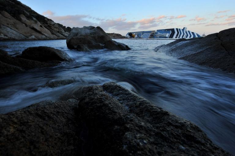 <p>The Cruise ship Costa Concordia lies stricken off the shore of the island of Giglio in Giglio Porto, Italy.</p>