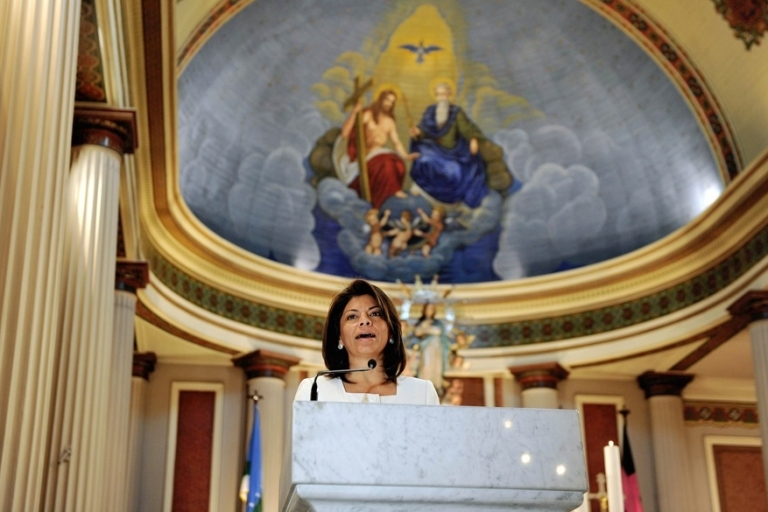 <p>Church and state: Costa Rican President Laura Chinchilla speaks during mass at the main Cathedral in San Jose. In deeply Catholic Costa Rica, the Supreme Court banned in-vitro fertilization.</p>