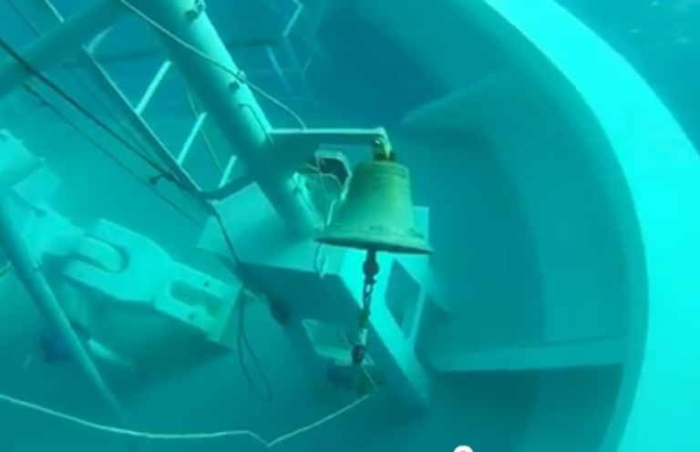 <p>A still image taken from a YouTube video shows the bell of the stricken Costa Concordia on its submerged bow.</p>