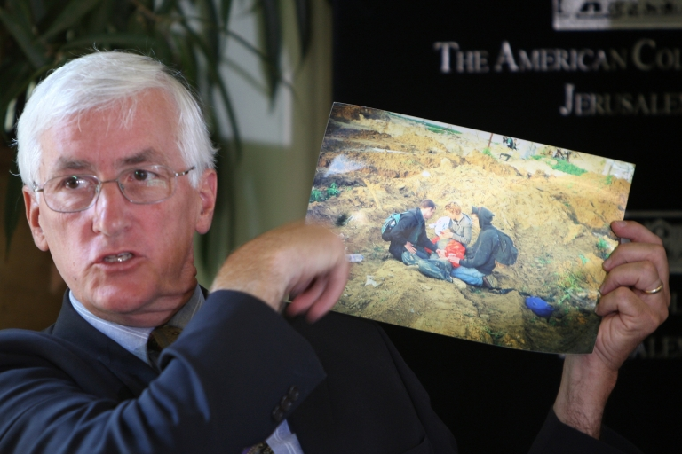 <p>Craig Corrie displays a picture from the site Rachel was killed.</p>
