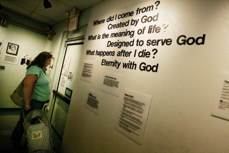 <p>In this 2005 photo, a visitor checks out a display at the Museum of Creation and Earth History in Santee, California. The museum contains exhibits that depict the story of creationism and refute the scientific theory of evolution.</p>