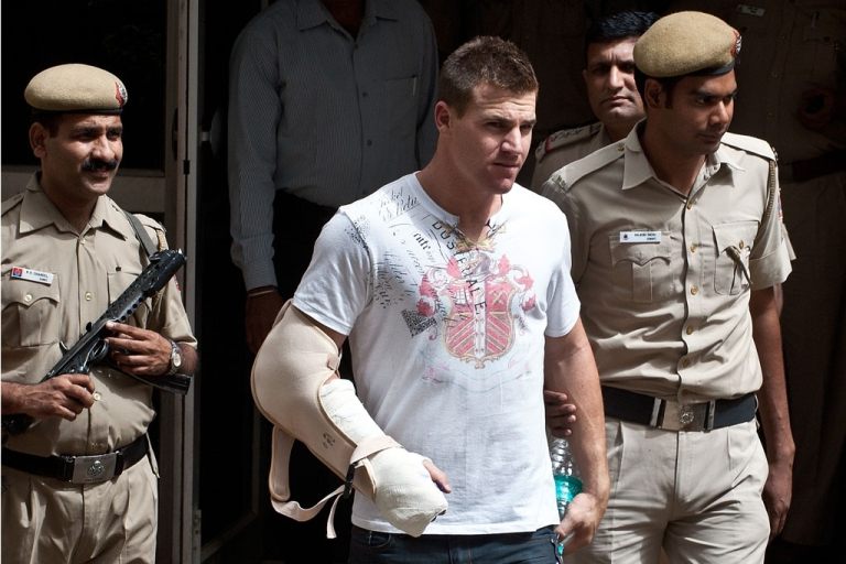 <p>Delhi policemen escort Australian cricketer Luke Pomersbach to his court appearance in New Delhi on May 18, 2012. Indian police have charged Pomersbach with molesting a woman and badly beating up her fiance after a late-night party at a posh New Delhi hotel.</p>