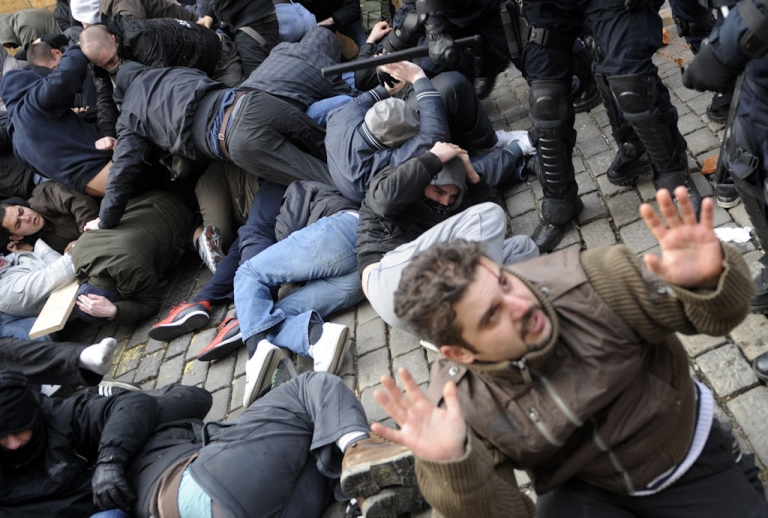 <p>Policemen clash with protesters during a demonstration in Zagreb on Feb. 26, 2011. Hundreds of anti-government protesters clashed with police leaving 33 people injured while several dozen were detained.</p>