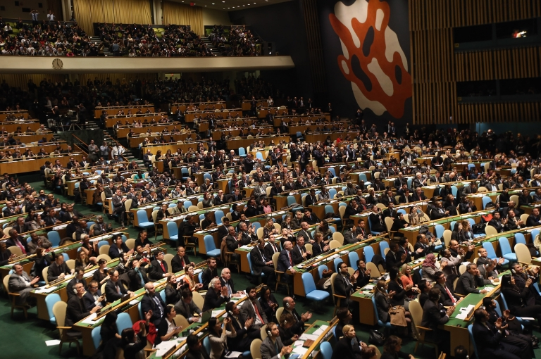 <p>UN General Assembly members applaud after granting 'non-member observer' status to Palestine on Nov. 29, 2012 in New York City.</p>
