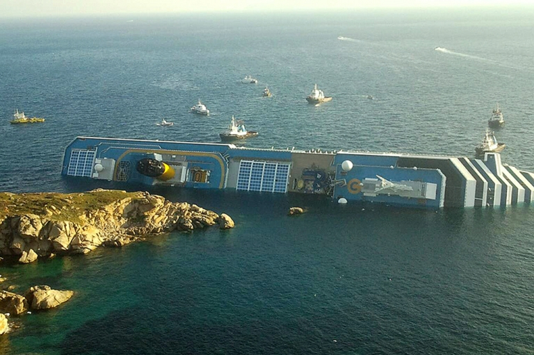 <p>A photograph taken early on January 14, 2012 of the Costa Concordia after the cruise ship with more than 4,000 people on board ran aground and keeled over off the Isola del Giglio, and Italian island, Friday night.</p>