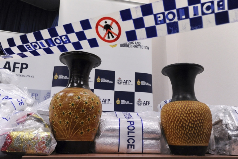 <p>Australian Federal Police (AFP) display ceramic vases used to conceal 525 million USD worth of crystal methamphetamine ('ice') and heroin after smashing a Hong Kong-based international drugs syndicate in Sydney on July 31, 2012. It was the largest haul of ice (306 kilograms) in Australian history and the third-biggest heroin bust (252 kilograms) and was the culmination of an 11-month operation following a tip-off from the US Drug Enforcement Administration.</p>