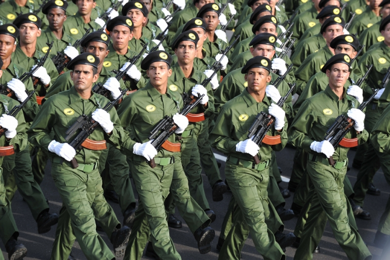 <p>Cuban special forces march, on April 16, 2011 in Havana, during the military parade to commemorate the 50th anniversary of the Bay of Pigs and the beginning of the Cuban Communist Party 6th Congress.</p>