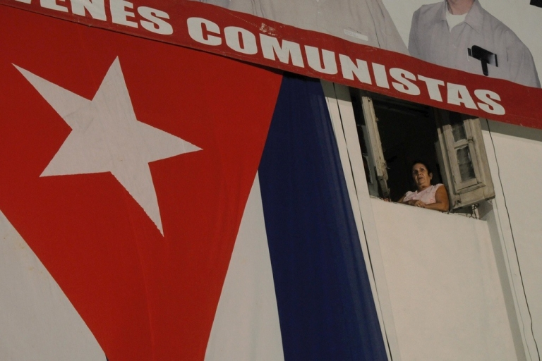 <p>A Cuban woman observes from a balcony celebrations marking the 156th birth anniversary of renowned Cuban poet and national hero Jose Marti, Jan. 28, 2009.</p>
