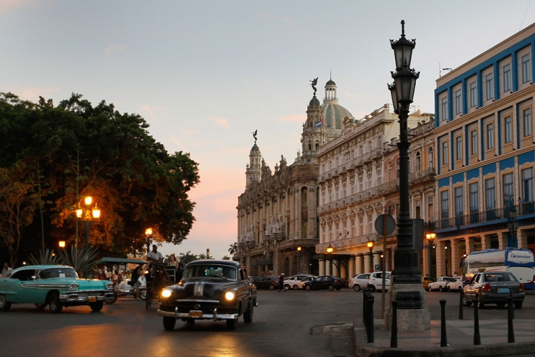 <p>Cars drive through the streets on March 26, 2012 in Havana, Cuba.</p>