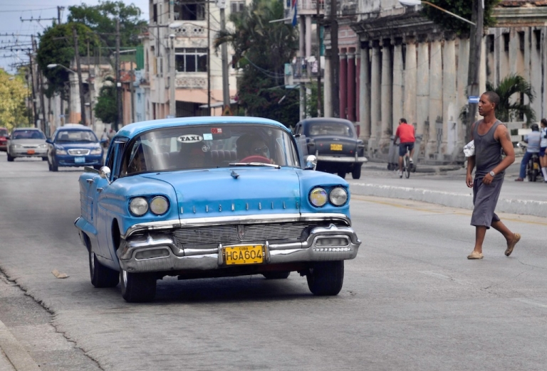 <p>A private taxi drives along a street on Sept. 28, 2011 in Havana.</p>