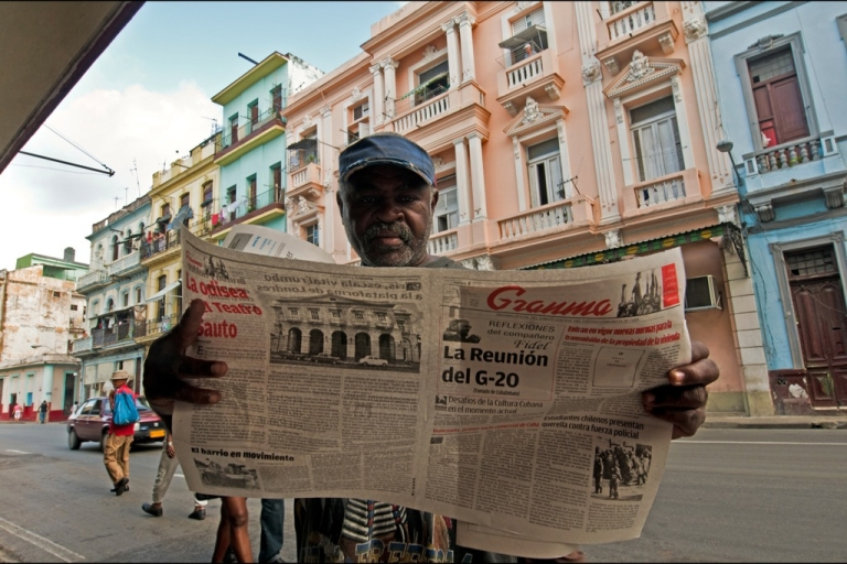 <p>A Cuban reads the Granma newspaper announcing the new housing law, on Nov. 3, 2011 in Havana. The law allows citizens to buy and sell homes for the first time in 50 years.</p>
