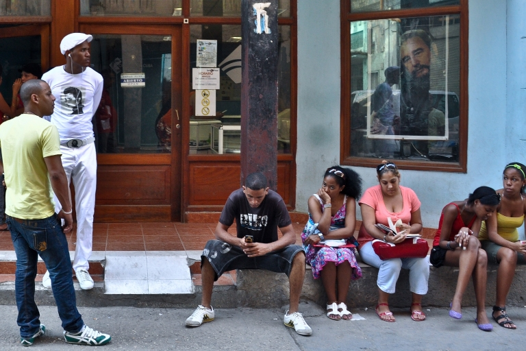 <p>Cubans wait their turn outside an internet center in Havana.</p>