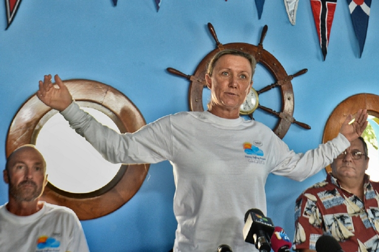 <p>British-born Australian marathon swimmer, Penny Palfrey,  accompanied by her husband Chris Palfrey (L) and Cuban commodore of the Nautic Club, Jose Miguel Diaz (R), gives a press conference in Havana ahead of her attempt to swim across 103 miles of shark-invested waters to Florida.</p>