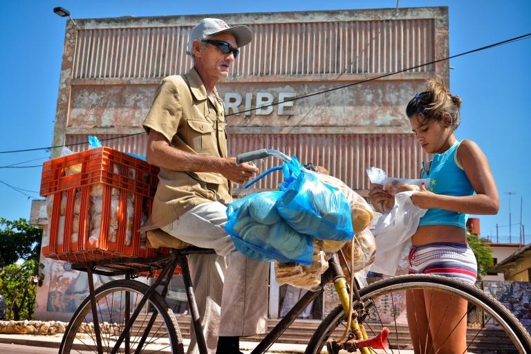 <p>A Havana street vendor sells bread.</p>