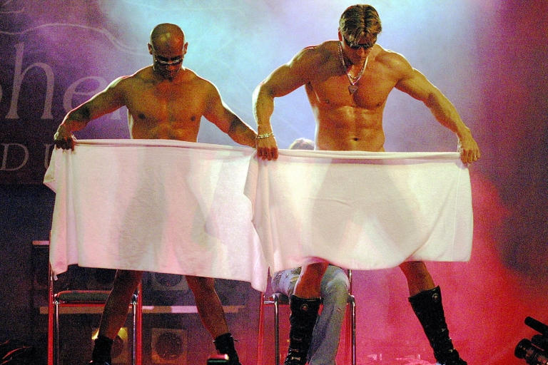 <p>Two Czech male extras perform a 'Chippendale' erotic dance during a four-day erotic culture fair Erotica Sex 2004 at the Prague Exhibition Grounds.</p>